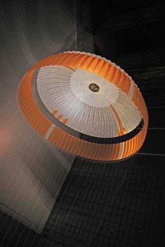 Parachutes open under the water and connected to pipes to collect oil  spills